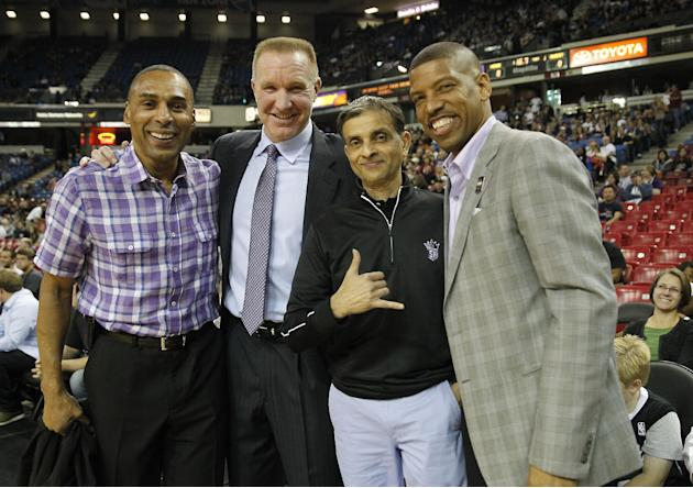 Former San Francisco 49ers running back Roger Craig, left, NBA Hall of Fame guard Chris Mullen, second from left, Sacramento Kings majority owner Vivek Ranadive, third from left and Sacramento Mayor K