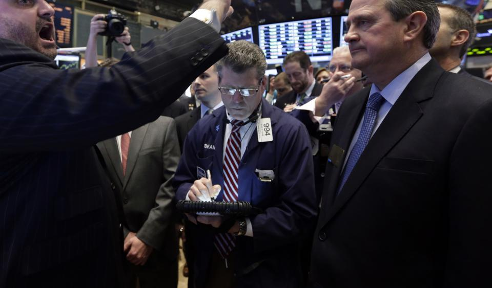 Stocks pull back from record levels on Wall Street