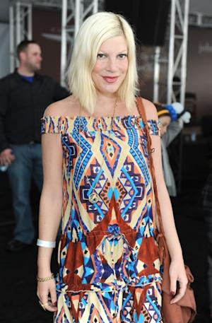 Tori Spelling sports a print dress at John Varvatos 9th Annual Stuart House Benefit held at John Varvatos Los Angeles in West Hollywood, Calif. on March 11, 2012 -- Getty Images