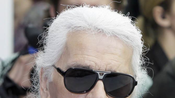 Fashion designer Karl Lagerfeld arrives for the show of Belgian fashion designer Kris Van Assche for Dior as part of the Men's Spring-Summer 2013 collection, for the Paris Fashion Week, in Paris, France, Saturday, June 30, 2012. (AP Photo/Francois Mori)