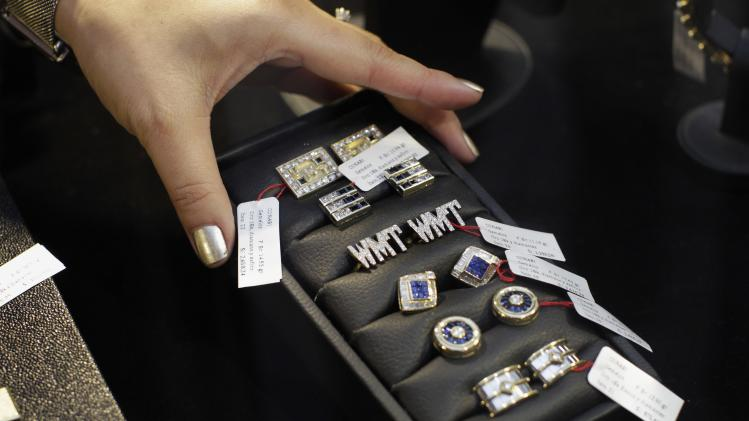 Pieces of jewelry confiscated from Peru's former head of Intelligence Vladimiro Montesinos are displayed to the media before auction, in Lima
