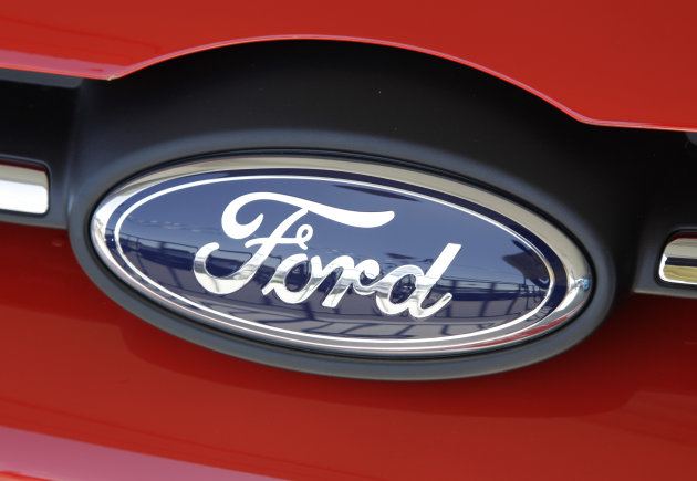 In this Tuesday, Aug. 30, 2011, photo, a Ford Focus is on display at a car dealership in San Jose, Calif. Ford's third-quarter net income eases 1 percent to $1.63 billion as European losses swamp record North American profits, the company announced Tuesday, Oct. 30, 2012. (AP Photo/Paul Sakuma)