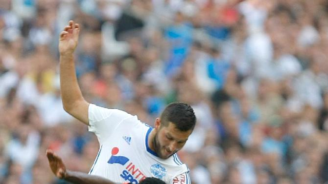 Marseille's French forward Andre-Pierre Gignac, left, challenges Rennes' French defender Steven Moreira for the ball during their League One soccer match, at the Velodrome Stadium, in Marseille, southern France, Saturday, Sept. 20, 2014. (AP Photo/Claude Paris)