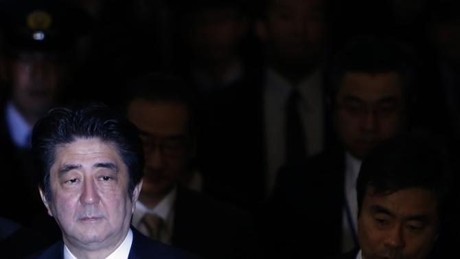 Japan's PM Abe walks to attend upper house committee session at parliament in Tokyo