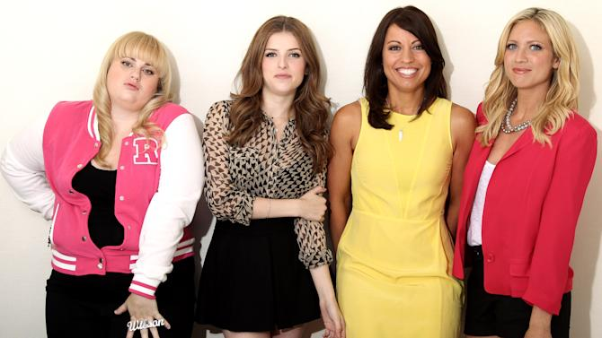 """In this image taken on Friday, Sept. 21, 2012, from left, actress Rebel Wilson, actress Anna Kendrick, screenwriter Kay Cannon, and actress Brittany Snow, from the film """"Pitch Perfect,"""" pose for a portrait at The London Hotel, in West Hollywood, Calif. Ever since the R-rated 2011 comedy """"Bridesmaids"""" became a runaway hit, taking in more than $280 million worldwide and earning Oscar nods, a rash of female-written comedies are enticing viewers with provocative new characters and diverse perspectives on the female experience. (Photo by Matt Sayles/Invision/AP)"""