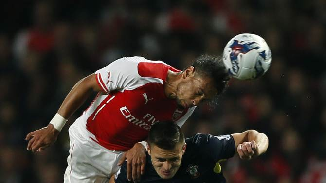 Arsenal's Coquelin challenges Southampton's Tadic during their English League Cup soccer match at the Emirates stadium in London