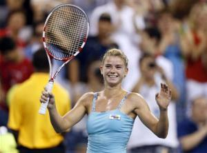 Camila Giorgi of Italy celebrates defeating Caroline Wozniacki of Denmark at the U.S. Open tennis championships in New York