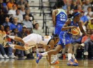 New York Liberty's DeMya Walker (22) is called for an illegal screen as teammate Essence Carson, right, drives with the ball and Connecticut Sun's Renee Montgomery, left, falls to the court during the second half of a WNBA basketball game in Uncasville, Conn., Saturday, Aug. 18, 2012. Connecticut won 85-74. (AP Photo/Jessica Hill)