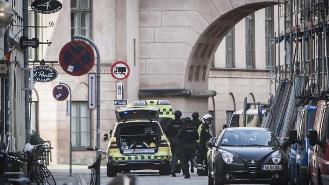 Authorities arrive at the scene of a shooting at a court building in Copenhagen