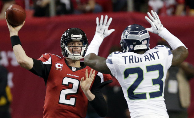 Atlanta Falcons quarterback Matt Ryan (2) throws against Seattle Seahawks cornerback Marcus Trufant (23) during the second half of an NFC divisional playoff NFL football game Sunday, Jan. 13, 2013, in