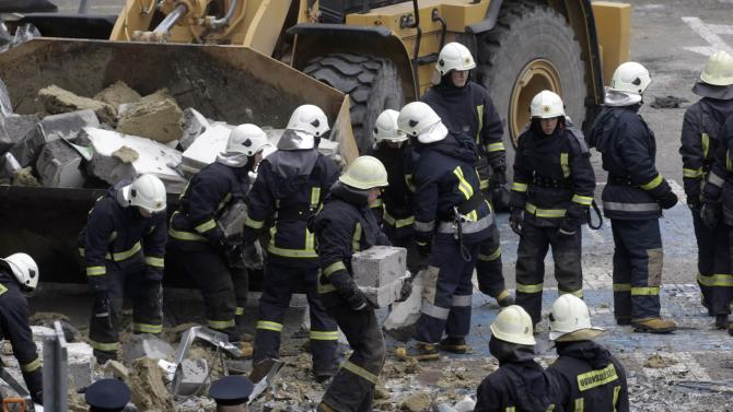 Firefighters remove debris from a collapsed supermarket in capital Riga