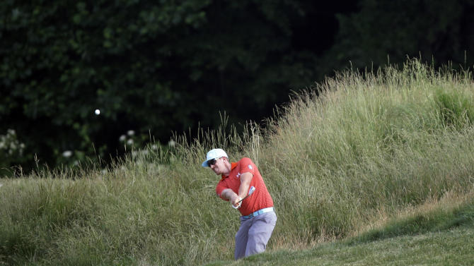 Hunter Mahan hits down the 12th hole during the third round of the U.S. Open golf tournament at Merion Golf Club, Saturday, June 15, 2013, in Ardmore, Pa. (AP Photo/Morry Gash)