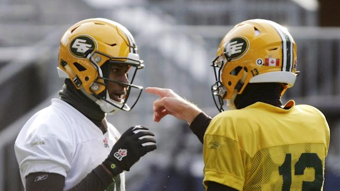 Edmonton Eskimos' Adarius Bowman and quarterback Mike Reilly practice ahead of the CFL 103rd Grey Cup championship football game in Winnipeg