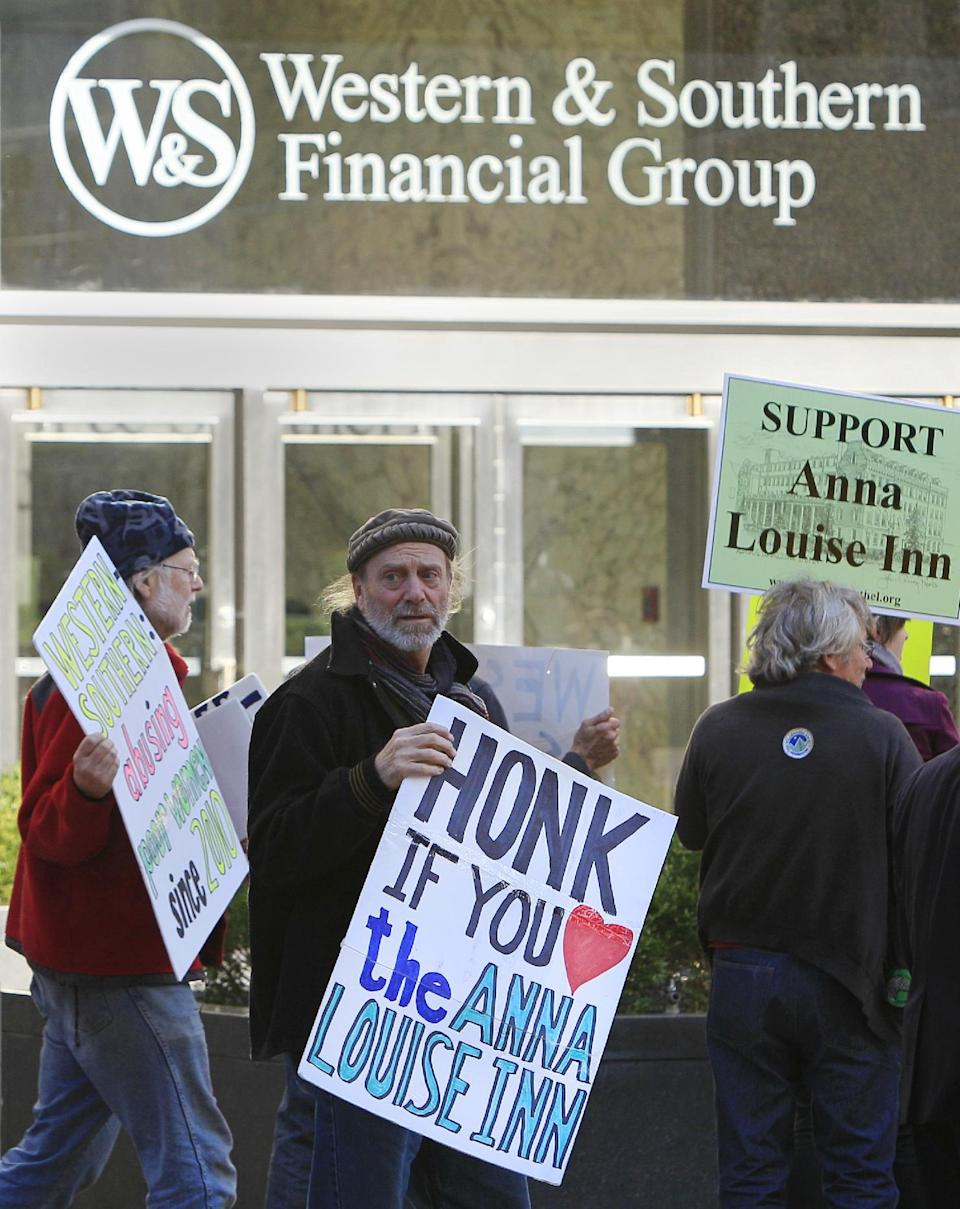 Supporters of the Anna Louis Inn demonstrate outside the headquarters building of Western & Southern Financial Group, Monday, Oct. 8, 2012, in Cincinnati. Western & Southern wants the 103 year old inn for women to leave the picturesque downtown neighborhood that they share in favor of a boutique hotel. (AP Photo/Al Behrman)