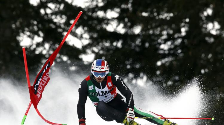 Moelgg of Italy clears a gate during the first run in the men's World Cup giant slalom skiing race in Alta Badia