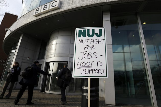 A National Union of Journalists, NUJ, placard taped to a post outside the BBC Television Centre in White City, London,  Monday, Feb. 18, 2013. BBC journalists have gone on strike for 24 hours after th