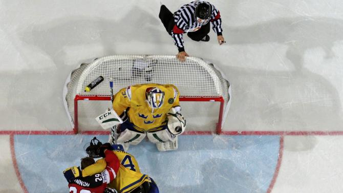 Officials intervene in a scuffle between Canada's MacKinnon and Sweden's Kronwall during their Ice Hockey World Championship game at the O2 arena in Prague