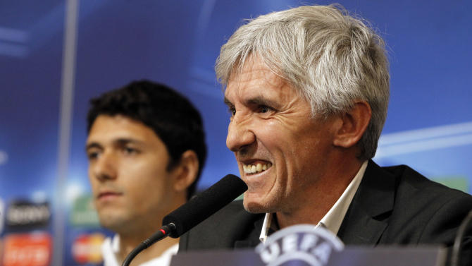 Apoel Nicosia's coach Ivan Jovanovic of Serbia, right, smiles as Helio Pinto, left, looks on during a press conference in Lyon, central France, Monday, Feb. 13, 2012. Apoel Nicosia will face Lyon in a Champions League soccer match on Tuesday. (AP Photo/Laurent Cipriani)