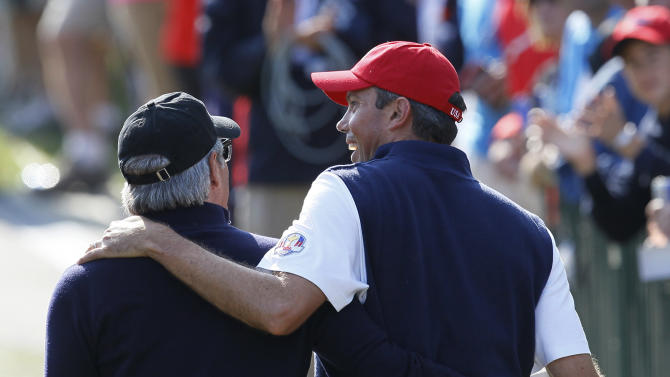 Fred Couples, left, walks with USA's Matt Kuchar on the seventh hole during a four-ball match at the Ryder Cup PGA golf tournament Friday, Sept. 28, 2012, at the Medinah Country Club in Medinah, Ill. (AP Photo/Charles Rex Arbogast)