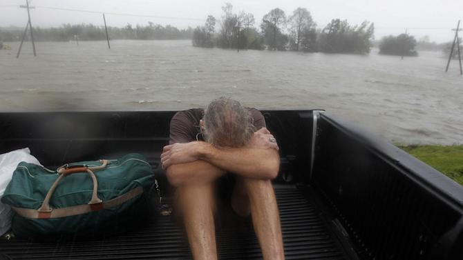 Residents who were rescued from their flooded homes are transported to waiting assistance, after Hurricane Isaac made landfall and flooded homes with 10 feet of water in Braithwaite, La., Wednesday, Aug. 29, 2012. Isaac was packing 80 mph winds, making it a Category 1 hurricane. It came ashore early Tuesday near the mouth of the Mississippi River, driving a wall of water nearly 11 feet high inland and soaking a neck of land that stretches into the Gulf.  (AP Photo/Gerald Herbert)