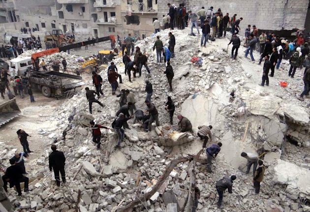 This citizen journalism image provided by Aleppo Media Center, AMC, which has been authenticated based on its contents and other AP reporting, shows people searching through the debris of destroyed buildings after airstrikes hit the neighborhood of Eastern Ansari, in Aleppo, Syria, Sunday, Feb. 3, 2013. The Britain-based activist group Syrian Observatory for Human Rights, which opposes the regime, said government troops bombarded a building in Aleppo&#39;s rebel-held neighborhood of Eastern Ansari that killed over 10 people, including at least five children. (AP Photo/Aleppo Media Center, AMC)