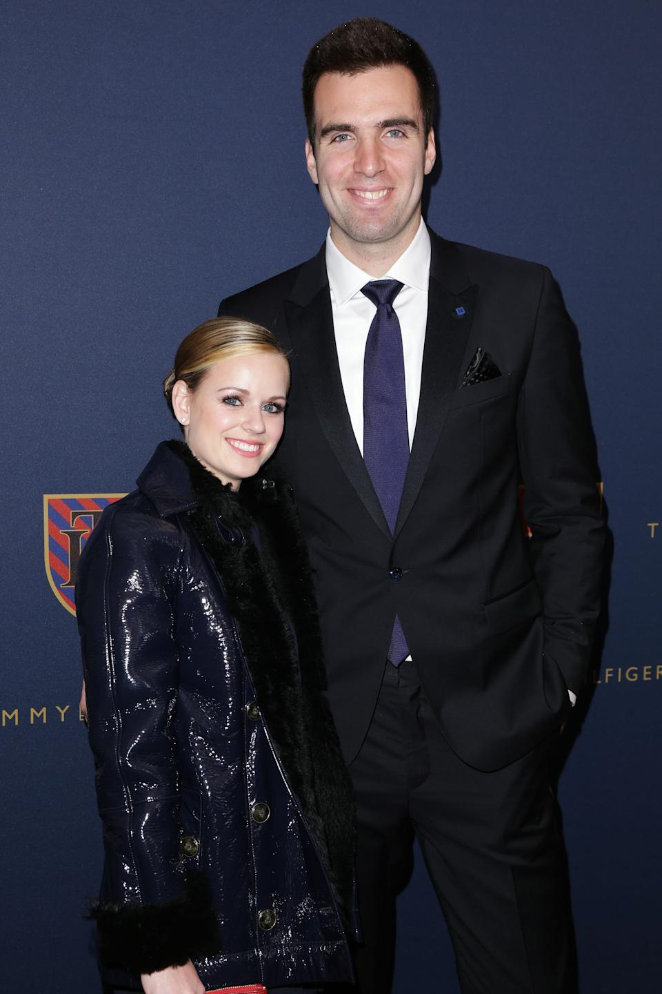 This image released by Starpix shows Baltimore Ravens quarterback Joe Flacco, right, and his wife Dana Grady at the Tommy Hilfiger Men's Fall 2013 collection, Friday, Feb. 8, 2013 during Fashion Week in New York. (AP Photo/Starpix, Andrew Toth)
