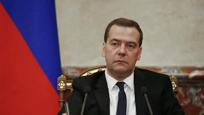 Russia's Premier Dmitry Medvedev holds the cabinet meeting at the government headquarters in Moscow, Russia, Thursday, Jan. 29, 2015. Russia's Sports Minister says the government will cut the budget for hosting the 2018 World Cup as part of plans to slash state expenditure while recession looms.  The Russian government is cutting its spending by 10 percent across the board after the central bank predicted last month that the economy could contract by up to 4.7 percent this year. (AP Photo/RIA Novosti, Dmitry Astakhov, Government Press Service)