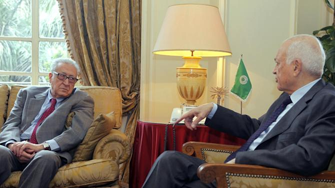 Arab League Secretary-General Nabil al-Araby, right, meets with U.N.-Arab League international Syria mediator Lakhdar Brahimi at the Arab league headquarters in Cairo, Egypt, Monday, March 18, 2013. The fighting in Syria has settled into a bloody stalemate and shows no signs of stopping, despite several tentative proposals from both sides to find a peaceful resolution to the conflict. (AP Photo/Amr Nabil)