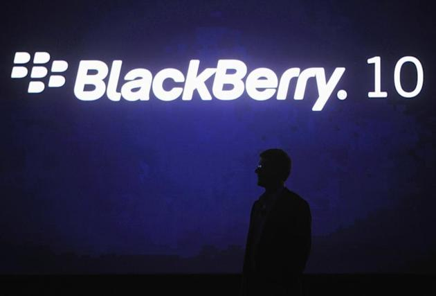 RIM CEO Heins is silhouetted during the BlackBerry World event in Orlando