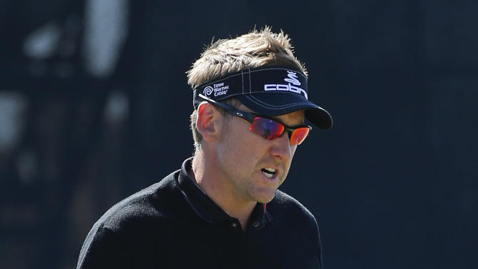 England's Ian Poulter reacts after sinking a putt on the third green in the quarterfinal round of play against Steve Stricker at the Match Play Championship golf tournament, Saturday, Feb. 23, 2013, in Marana, Ariz. (AP Photo/Ross D. Franklin)