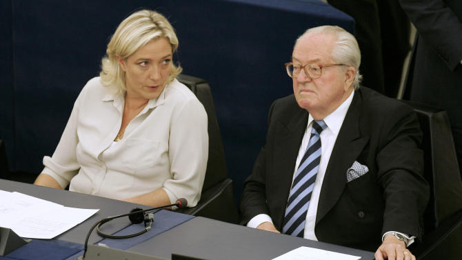 FILE - In this July 14, 2009 file photo, French European deputy Jean-Marie Le Pen, right and his daughter Marine Le Pen sit at the European Parliament, in Strasbourg, eastern France. French far-right leader Marine Le Pen has been stripped of her European Parliament immunity and may now face charges of racism over comments she made comparing Muslim street prayers to an occupation of French territory. Le Pen has reiterated the remarks first made in 2010 and on Tuesday July 2, 2013 said she stands behind them and looks forward to defending her comments in front of a judge. (AP Photo/Lionel Cironneau, File)