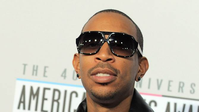 Ludacris, born Chris Bridges, arrives at the 40th Anniversary American Music Awards on Sunday, Nov. 18, 2012, in Los Angeles. (Photo by Jordan Strauss/Invision/AP)