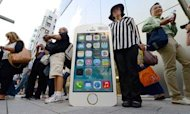 Apple iPhones And iOS 7 Break Records