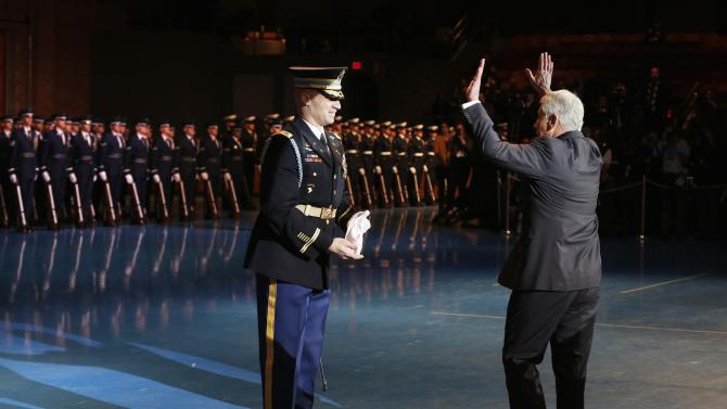 Hagel waves to the troops during a farewell ceremony in Virginia