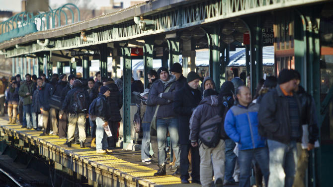 In this Tuesday, Feb. 5, 2013 photo, rush hour commuters crowd a subway platform at the Woodside station in Queens, N.Y. The station is a transfer point for passengers traveling on the Long Island Rail Road (LIRR) and going to Manhattan's East Side. The Second Avenue Subway construction will ease congestion at the station when it opens, giving the LIRR a stop on the East Side it now bypasses straight to Penn Station on the West Side.  (AP Photo/Bebeto Matthews)
