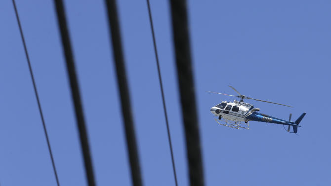 A helicopter from the California Highway Patrol aids in the search for missing 8-year-old girl Madyson Middleton Monday, July 27, 2015, in Santa Cruz, Calif. Police and volunteers were searching Monday for a missing 8-year-old girl a day after she vanished from a Northern California artist community center where she lives with her mother. Madyson Middleton was last seen Sunday afternoon riding a scooter outside the Tannery Arts Center in Santa Cruz, a beach town along the Northern California coast. (AP Photo/Ben Margot)