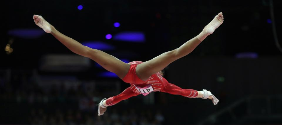 U.S. gymnast Gabrielle Douglas performs on the uneven bars during the Artistic Gymnastics women's team final at the 2012 Summer Olympics, Tuesday, July 31, 2012, in London. (AP Photo/Julie Jacobson)