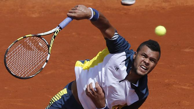 France's Jo-Wilfried Tsonga serves the ball to Slovenia's Aljaz Bedene during their first round match of the French Open tennis tournament at the Roland Garros stadium Monday, May 27, 2013 in Paris. Tsonga won 6-2, 6-2, 6-3. (AP Photo/Michel Spingler)