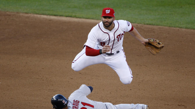 Nationals second baseman Danny Espinosa tries for a double play as St. Louis Cardinals' Craig slides safely into second base during the sixth inning in Game 4 of their MLB NLDS baseball series in Washington