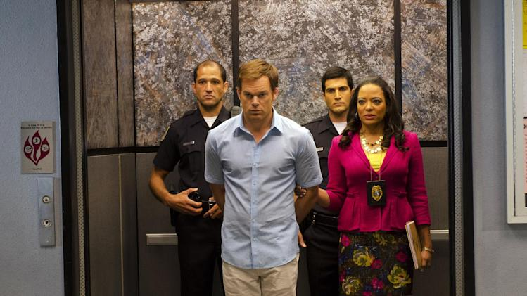 "This undated publicity photo released by Showtime shows Michael C. Hall, front left,  as Dexter Morgan and Lauren Velez as Maria LaGuerta in a scene from  ""Dexter,"" Season 7, episode 12. The end is coming for ""Dexter,"" Showtime's serial killer drama. The cable channel said Thursday, April 18, 2013, that the series' upcoming eighth season will be its last. (AP Photo/Showtime, Randy Tepper)"
