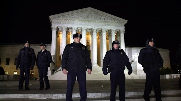 "FILE - This Dec. 12, 2000 file photo shows Supreme Court police lining the steps of the court in Washington, as the nation awaits the court's ruling on the Florida presidential election. The mere mention of the 2000 election unsettles people in Palm Beach County. The county's poorly designed ""butterfly ballot"" confused thousands of voters, arguably costing Democrat Al Gore the state, and thereby the presidency.  Gore won the national popular vote by more than a half-million ballots. But George W. Bush became president after the Supreme Court decided, 5-4, to halt further Florida recounts, more than a month after Election Day. Bush carried the state by 537 votes, enough for an Electoral College edge, and the White House.  (AP Photo/Kenneth Lambert, File)"