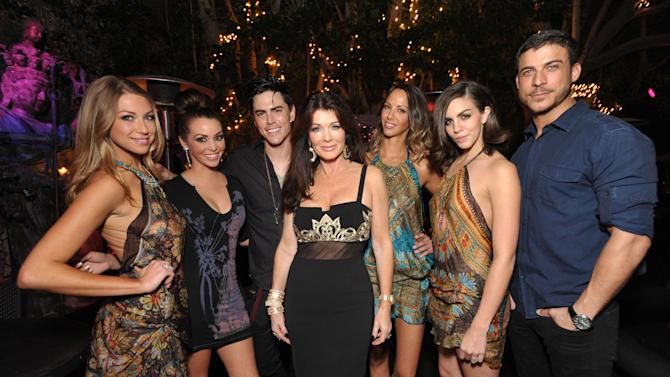 """IMAGE DISTRIBUTED FOR BRAVO - From left, cast members Stassi Schroeder, Scheana Marie, Tom Sandoval, Lisa Vanderpump, Kristen Doute, Katie Maloney, and Jax Taylor pose for a photograph at the premiere party for """"Vanderpump Rules"""" at SUR restaurant, on Monday, Dec. 10, 2012 in Los Angeles. The show premieres on January 7, 2013 on Bravo.  (Photo by John Shearer/Invision for Bravo/ AP Images)"""