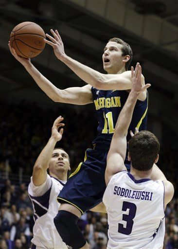 Burke, Hardaway lead Michigan past Wildcats, 94-66