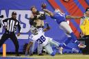 FILE - In this Nov. 23, 2014, file photo New York Giants wide receiver Odell Beckham Jr. (13) makes a one-handed catch for a touchdown against Dallas Cowboys cornerback Brandon Carr (39) in the second quarter of an NFL football game in East Rutherford, N.J. (AP Photo/Kathy Willens, File)