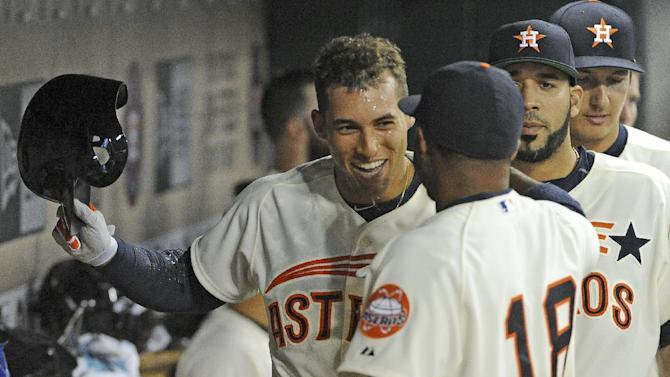 Houston Astros right fielder George Springer, left, celebrates his solo home run in the dugout with Luis Valbuena (18) in the sixth inning of a baseball game against the Los Angeles Angels, Saturday, April 18, 2015, at Minute Maid Park in Houston. (AP Photo/Eric Christian Smith)