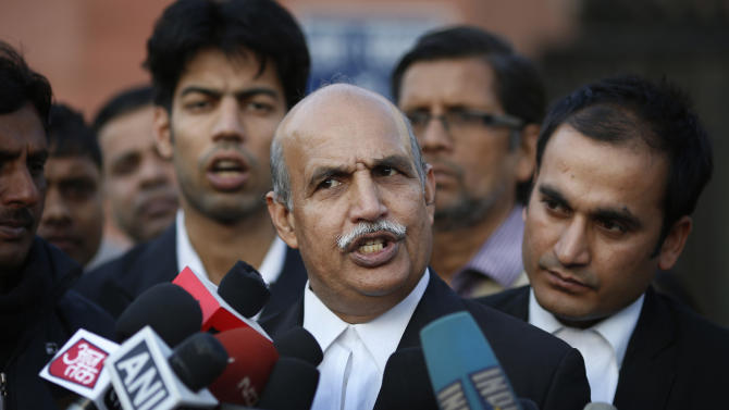 V.K. Anand, lawyer for one of the accused, speaks to journalists outside the Saket district court complex where the five men facing charges of rape and murder of a 23-year-old woman aboard a moving bus in the capital last month stand trial, in New Delhi, India, Monday, Jan. 21, 2013. Legal proceedings in the fatal gang-rape attack on the student in India's capital began Monday in a new fast-track court set up to deal specifically with crimes against women that has stirred debate over how best to deliver justice to rape victims.(AP Photo/ Saurabh Das)