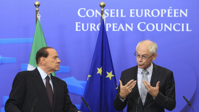 European Council President, Herman Van Rompuy, right, and Italy's Prime Minister, Silvio Berlusconi, address the media after they had a meeting, at the European Council building in Brussels, Tuesday, Sept. 13, 2011. (AP Photo/Yves Logghe)