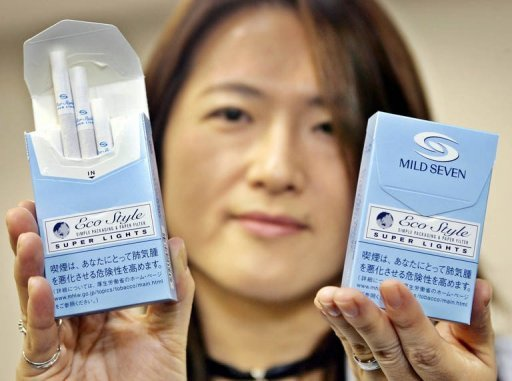 <p>This file photo shows Japan Tobacco (JT) official displaying 'Mild Seven Super Lights Eco Style' cigarrete boxes during a press preview in Tokyo, in 2005. JT shares jumped more than seven percent in Tokyo trade on Monday after the government said it would delay selling part of its stake in the former monopoly.</p>