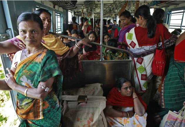 Women passengers travel in a crowded ladies compartment of a local train in Kolkata