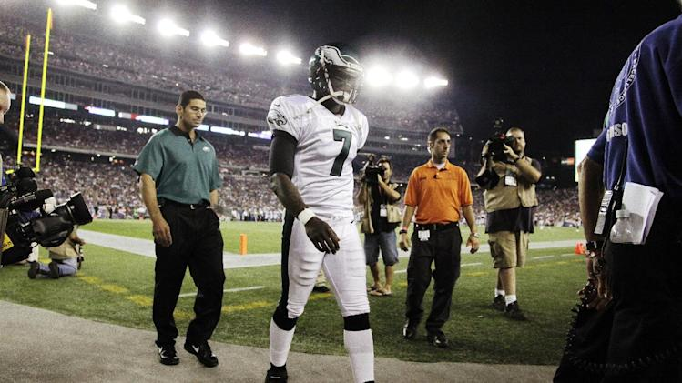 Philadelphia Eagles quarterback Michael Vick (7) leaves the field during the first quarter of an NFL preseason football game against the New England Patriots in Foxborough, Mass., Monday, Aug. 20, 2012. (AP Photo/Steven Senne)